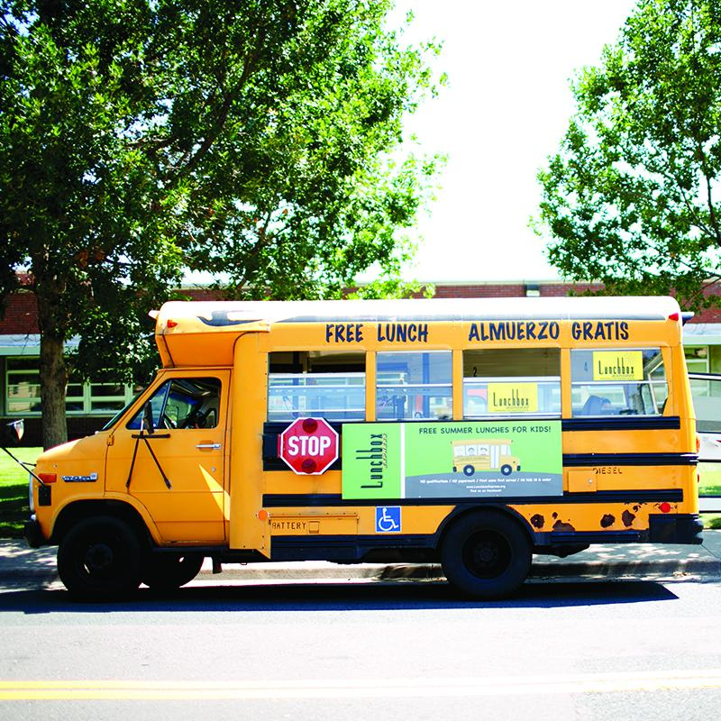 school bus with writing on the outside to promote summer meals