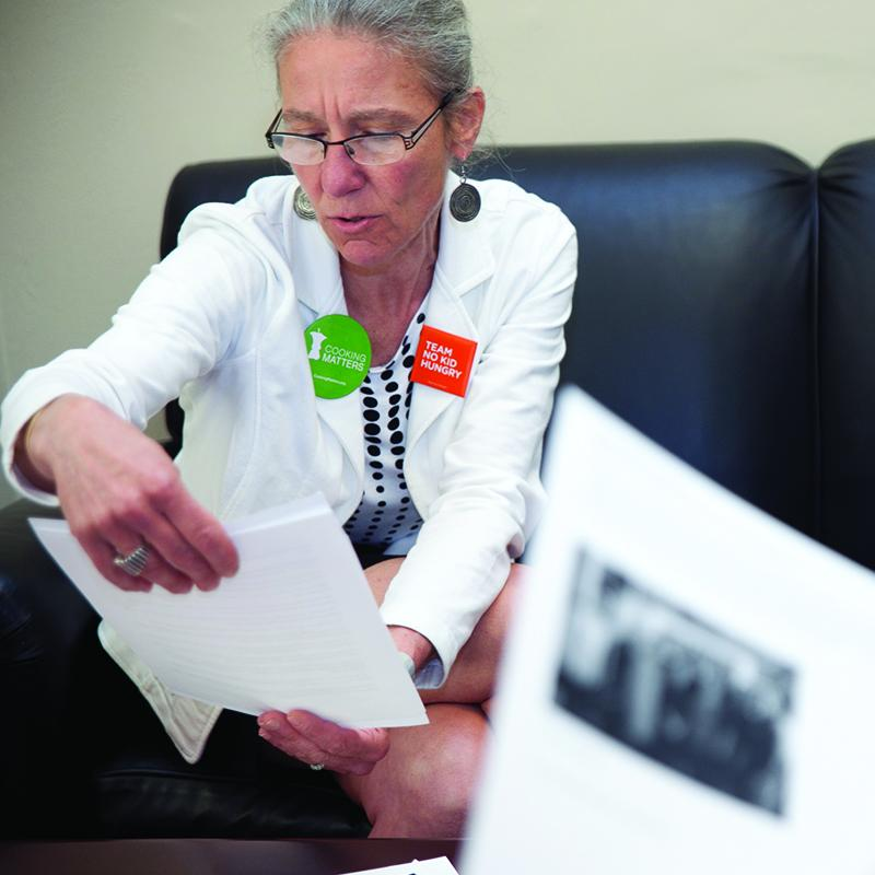 woman reviewing legislation