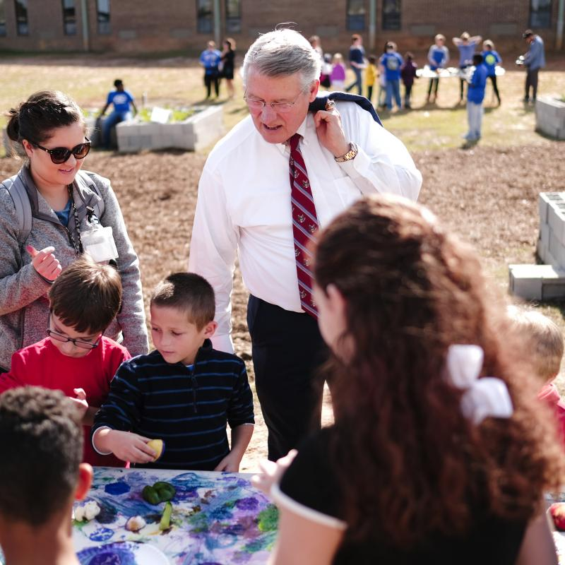 Congressman visiting school garden
