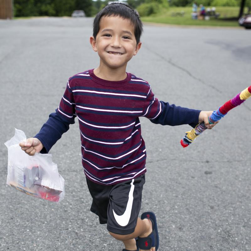 boy carrying a bagged lunch