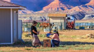 Chinle, Arizona, woman delivers meals to another woman's home against beautiful dessert landscape